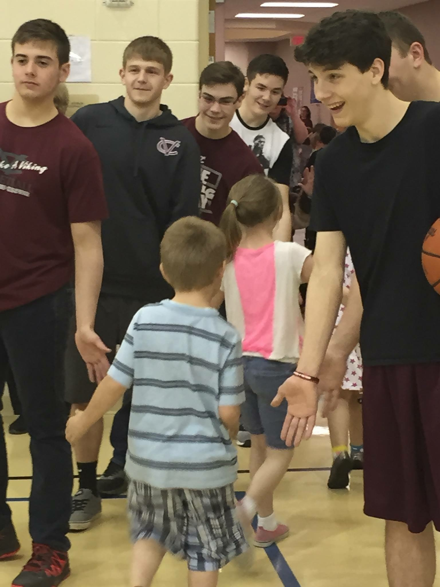 Central Gets a Surpise Visit From The VC Boys District Championship Basketball Team!