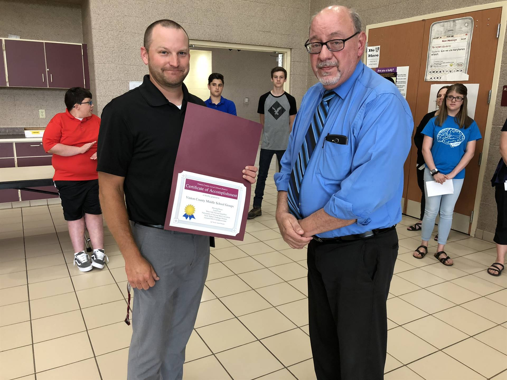 Mr. Ward accepting Middle School Recognition Certificate